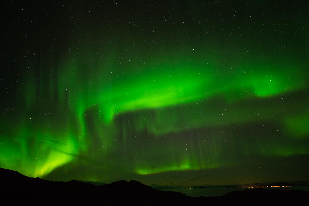 De grote beer badend in het noorderlicht. Fotograaf: Toine Westen, Lofoten